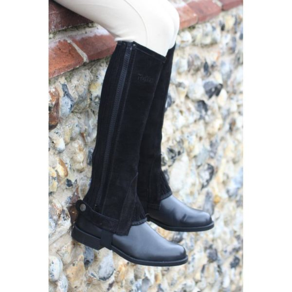 These are a real favourite with our customers. They love our suede half chaps as they are soft and supple whilst still being very hard wearing.Outer: Soft suede leatherFastener: YKK™ heavy duty zipAdditional features: Reinforced elastic stirrup, super-stretch gussets. The suede is durable and robust to last a long time under normal riding conditionsColours: Black and BrownThe chap incorporates a side YKK™ zip and a stretch panel for extreme comfort and fit.The suede is of a decent enough thickness to last a long time under normal riding conditions.Wide legs a specialty; customers with unusual leg sizes love our suede chaps as they are available in regular or short lengths and in an extensive range of calf sizes.