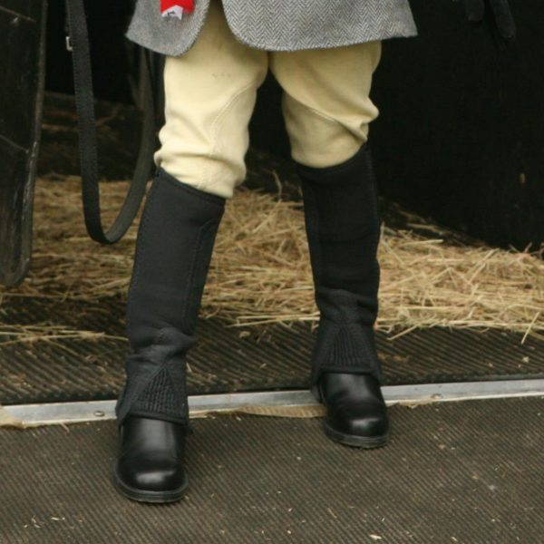 Our Cleveland neoprene half chaps are ideal for cold and damp conditionsOuter: NeopreneFastener: YKK™ zipAdditional features: Reinforced elastic stirrup, security strap and brass popperColours: Black and BrownSizes: Small - X LargeThe Neoprene has a natural water-repellent property which can be wiped or washed to remove dirt or grime.Warm and lightweight, these chaps are ideal for the colder seasons.Made from superior Neoprene with a YKK™ zip and elasticated side panel which gives the effect of a beautifully contoured chap.This chap also includes a reinforced elastic stirrup and a Tuffa zip closure to keep the zip in place whilst in use.